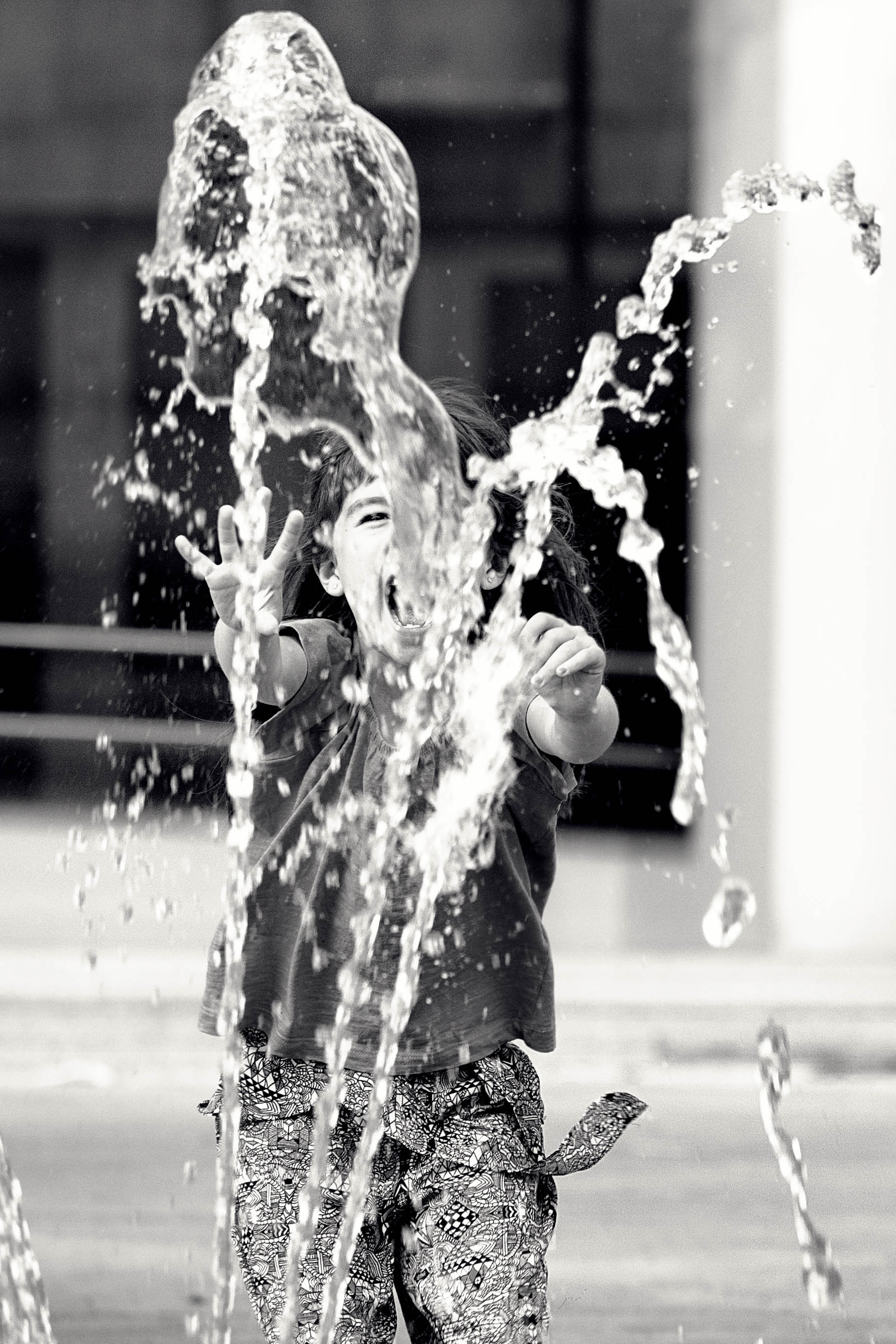 street photography girl fun fountain black and white bnw
